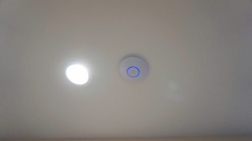 The Ubiquiti WAP is installed in the ceiling of the second floor for optimal coverage