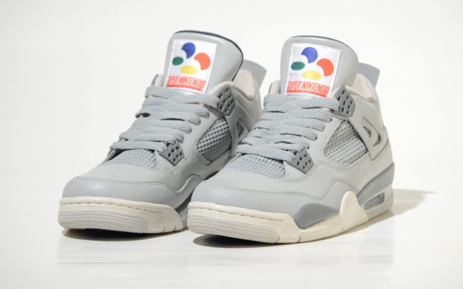 the latest cd86f eb68c You absolutely have to check out these custom Air Jordan 4 Super Nintendo  sneakers
