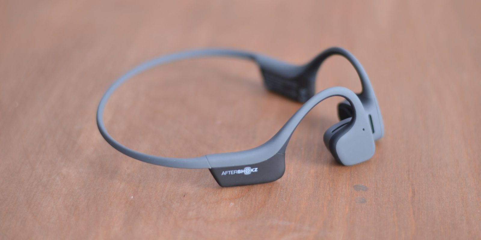 trekz air bone conduction headphones review hear music through your skull video  [ 1600 x 800 Pixel ]