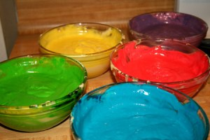 bowls of colored batter