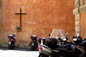 Even scooters pray in Rome