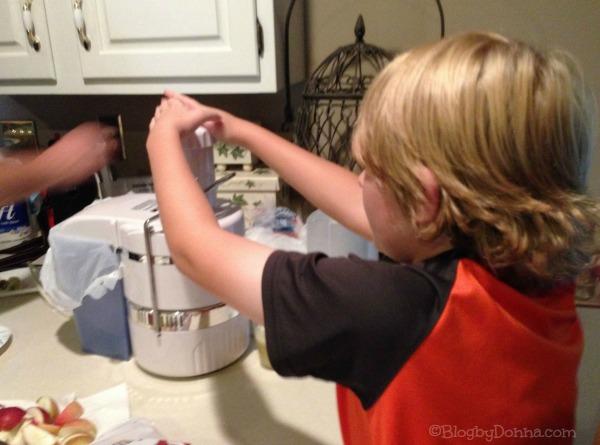 Cody making apple juice