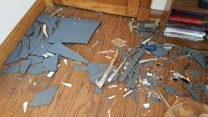 Broken pieces of mirror on floor.