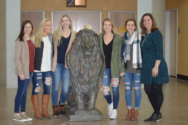 Photo: Kristen Majchrzak, development assistant for Compass Regional Hospice (far right,) visits with run organizers and Queen Anne's County High School National Honors Society members (left to right) Ruth Murdoch, Paige Richardson, Kylee Mills, Maisie Meehan and Julia Redpath.