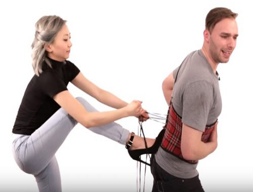 Men hilariously try on waist trainers and can't hack the pain.