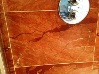 Damaged Marble Shower Tiles in Ringmer After