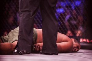 MMA fighter incapacitated by an illegal groin kick.