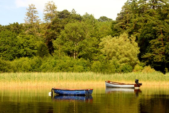 Boats rest waiting to take summer visitors around the lakes of Killarney