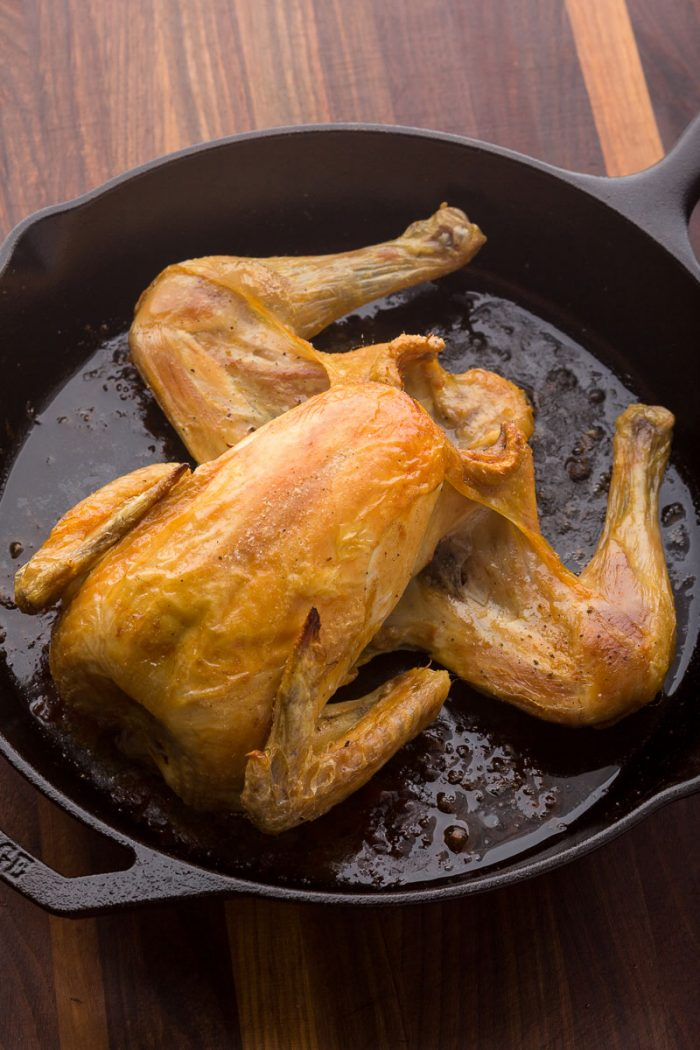 What a horrible presentation! A splayed open roast chicken in a cast-iron skillet.