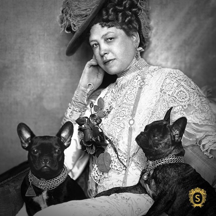 "Anna Sacher was known to be a passionate cigar smoker just like Sigmund Freud with whom she also shared the love for Sachertorte and dogs. She successfully used the Sachertorte as a tool to promote the Hotel. On this 1908 photograph by Madame d'Or she is seen with her two famous small French bulldogs that constantly accompanied her. (<a href=""https://www.sacher.com/"" target=""_blank"" rel=""noopener"">Hotel Sacher</a>)"