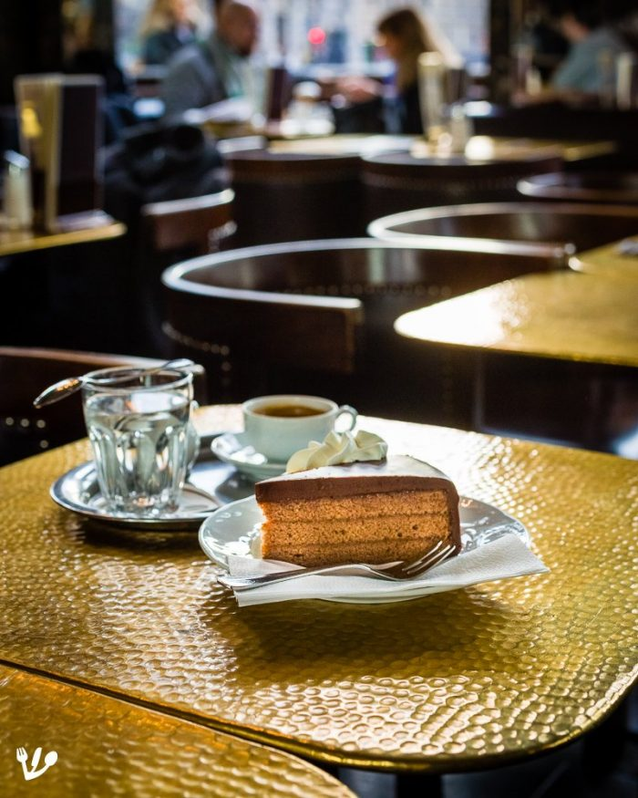 "You can get a slice of what is referred to as the ""real"" Sachertorte in Café Schwarzenberg's beautiful Damensalon (""ladies' salon""). Whole Sachertortes in wood boxes like those available at Hotel Sacher and Demel are sold at their confectionary store Leschanz – Wiener Schokoladekönig."
