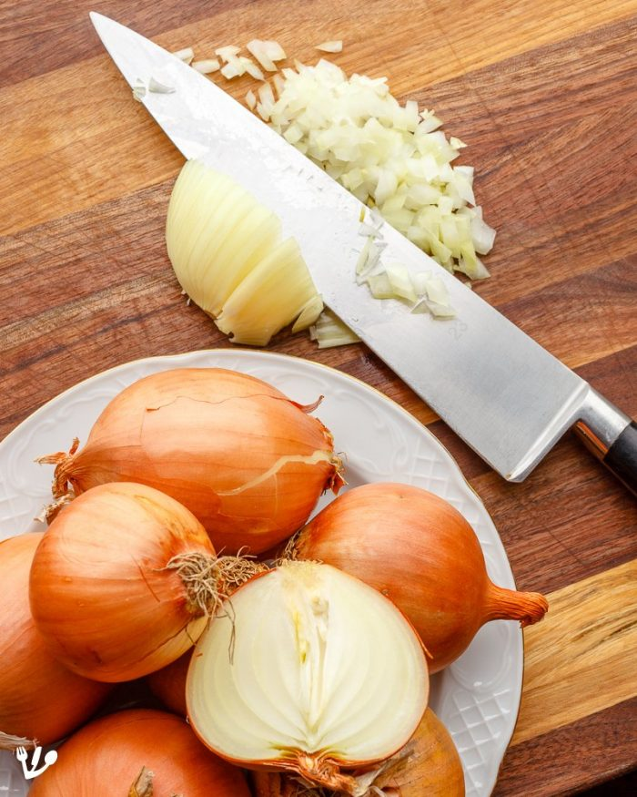 A 1:1 ratio of onions to meat is necessary to obtain the velvety gravy of a Viennese goulash. Dicing the onion might be the only hard part about goulash. (For very large quantities you might want to cheat with a food processor.)