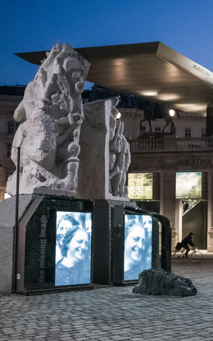 "Ruth Beckkermann completed the Memorial against War and Fascism on Albertina Platz with The Missing Image Installation in March 2015. In the foreground, the characteristically Austrian image of ""The Jew,"" crouching on the floor. The sculpture is often used as a bench, especially by tourists!"