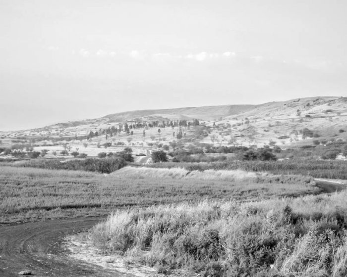 Hula Valley next to the Jordan River with Golan Heights ascending behind