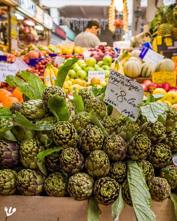 """""""Violetti"""", violet artichokes, another one of over sixty Italian varieties seen at the Mercato dell'Unità, in Rome. Artichokes are generally available from late December to at least the end of April. Because Vienna is relatively close, Italian artichokes were already available there during Freud's lifetimeand were eaten in his home as often as possible."""