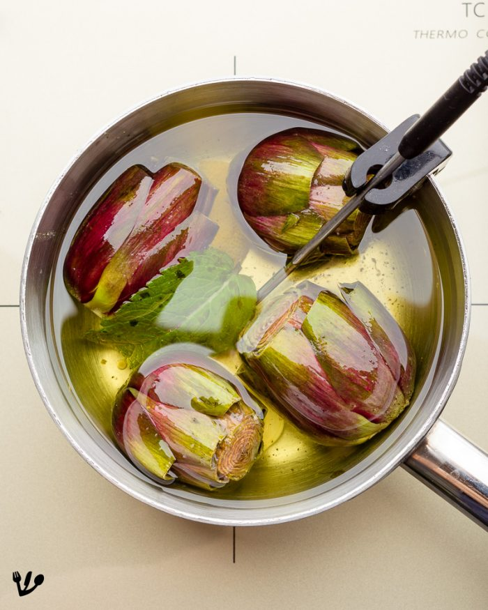 Baby artichokes confit, slowly cooked in a light vegetable oil with garlic, mint and lemon rind.