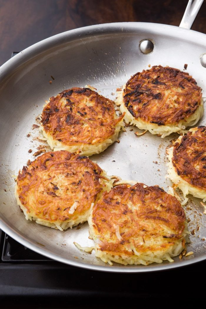 With parboiled potatoes, you don't have to worry about your latkes still being raw. Just flip them over when nicely browned and crisp around the edge.
