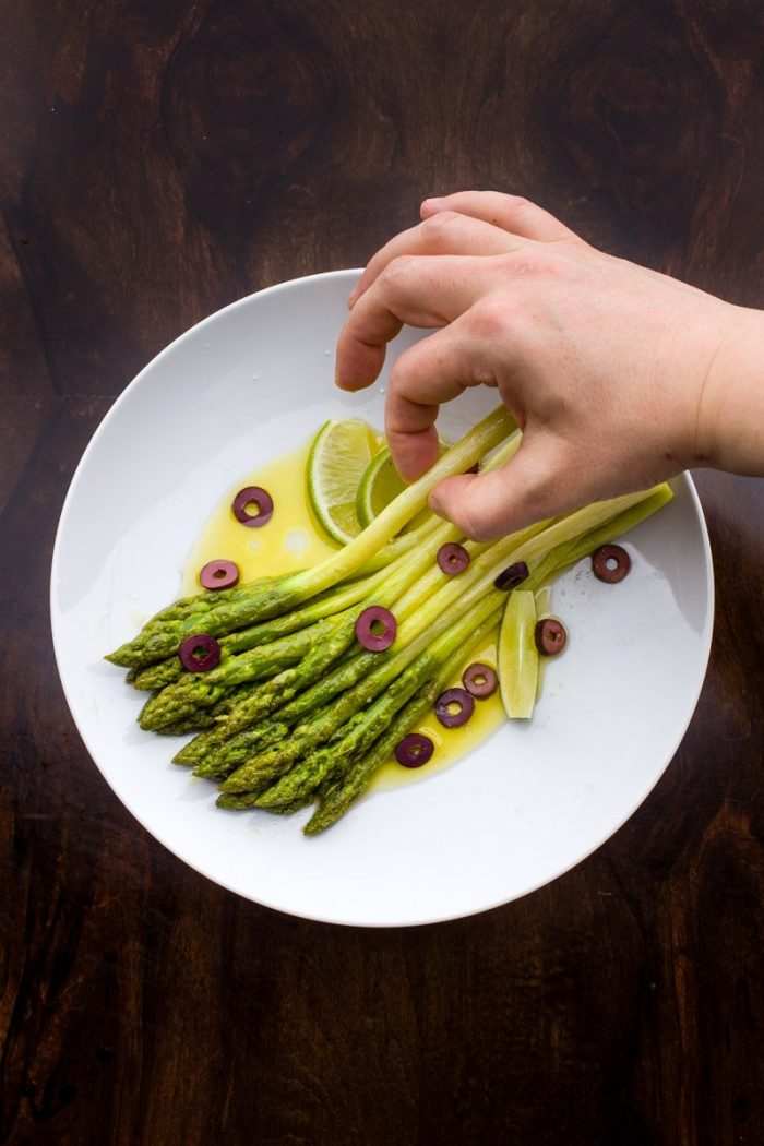 To the green asparagus add nothing but a very tasty extra virgin olive oil, a sprinkling of lime juice and maybe a few olives.