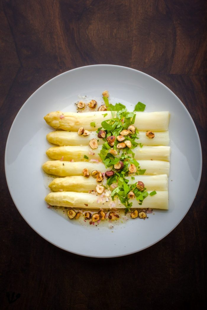 White asparagus tips with hazelnuts and a light lime juice-champagne vinaigrette. In Vienna people like breadcrumbs toasted in butter with their white asparagus, the hazelnut is related in taste but adds even more of the delicate nutty aromas.