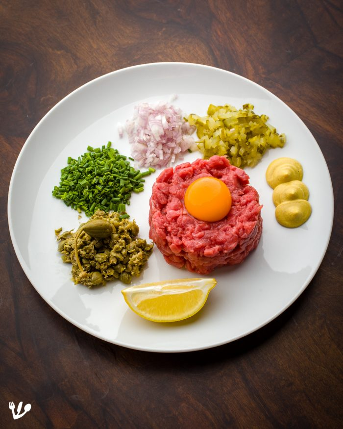 """There two ways to serve tartare: Either already mixed or left up to the guest. Serve Tabasco, Worcestershire sauce, salt, pepper, toasted bread and optional ketchup on the side. (I've got a<a href=""""https://JewishVienneseFood.com/speedy-old-vienna-no-knead-bread-altwiener-hausbrot/"""">speedy old-Vienna-style no-knead bread recipe</a>.)"""