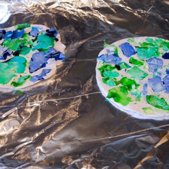 Step 5: Brush off any extra shell that didn't stick. Now you have a lovely mosaic Earth.