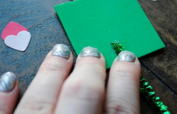 Step 5: Glue green chenille stem to bottom middle of green foam square