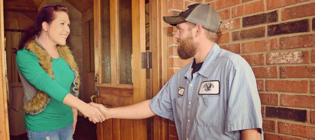 United Plumbing - Residential-Customers-Garbage-Disposal-Repair-Springfield-Missouri - image of woman greeting a repairman at the front door