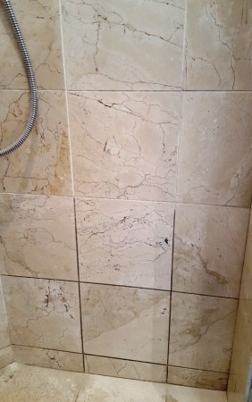 Marble Shower Enclosure Tiles During Cleaning in Beddau
