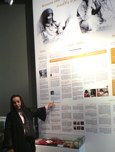 Prof. Rafia Ghubash explaining women's historical roles as exhibited in the Women's Museum