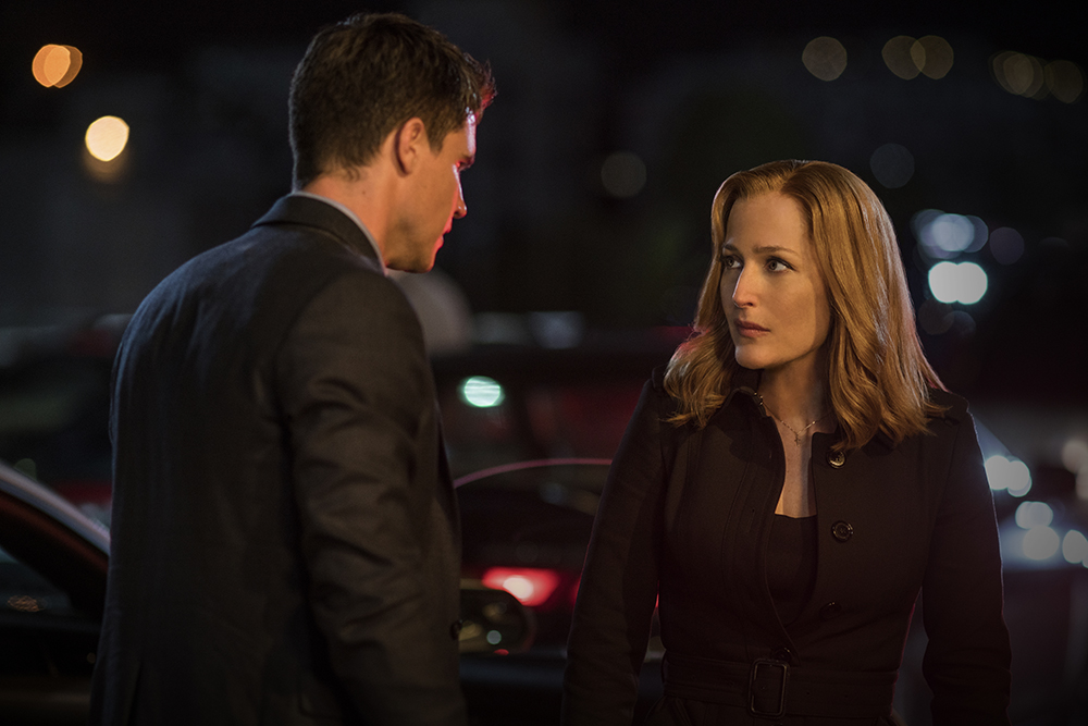 Scully and Miller having a quiet little chat while Mulder is dying....