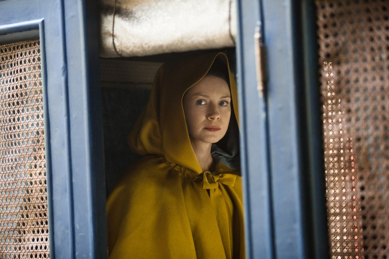 Claire in her yellow cloak, riding in the carriage. Why, Claire, why?