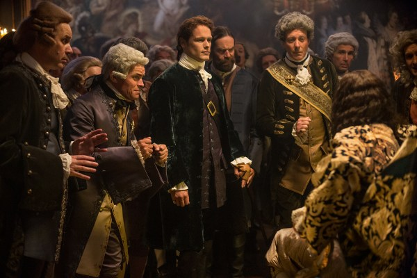Jamie and Murtagh meet the King, who is seated on his royal pooping chair.