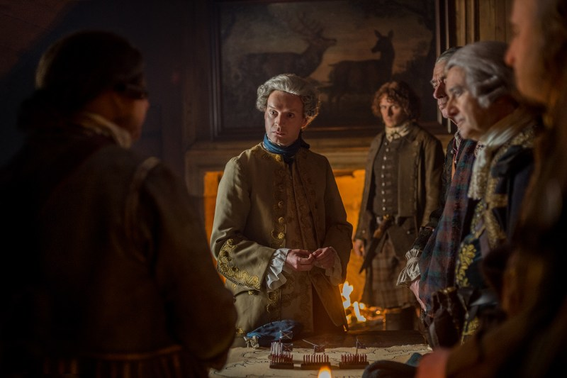 """Center: Prince Charles (Andrew Gower) saying, """"????????"""" Left: Jamie (Sam Heughan) being completely done with this."""