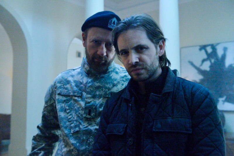 "12 MONKEYS -- ""Lullaby"" Episode 208 -- Pictured: (l-r) Xander Berkeley as Colonel Jonathan Foster, Aaron Stanford as James Cole -- (Photo by: Ben Mark Holzberg/Syfy)"