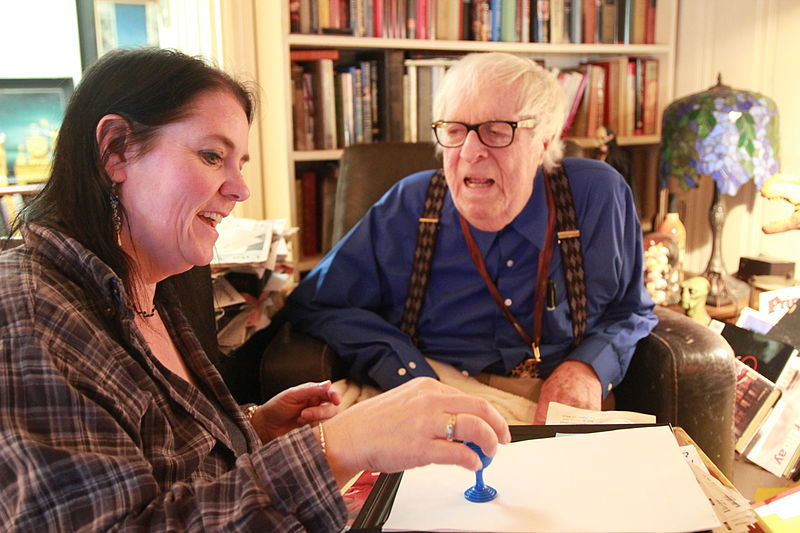 Susan Gerbic shows Ray Bradbury her ball and vase trick at his home August 2010