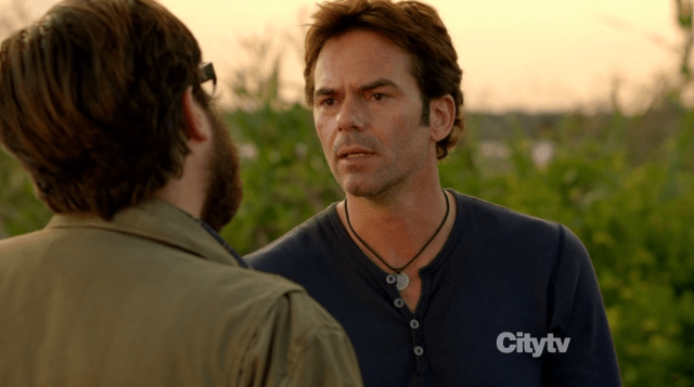 Aaron (Zak Orth) and Miles (Billy Burke) arguing over the pendant - Revolution