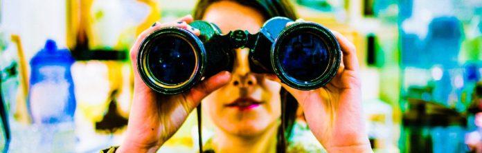 chase_elliott-binoculars-stock-woman-reflection-man-camera-espionage-spying-old-device-apperatus_crop