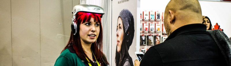 Citoyen du Monde Inc redhead girl explains wearable technology ces 2015