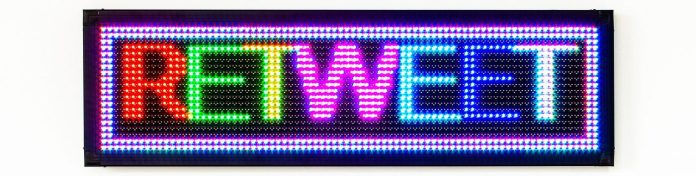 agoasi-retweet-twitter-rt-symbol-lights-colourful-wall_edited