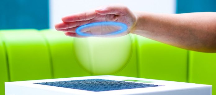 UltraHaptics-Review-Touch-Forcefield-hand-touching-Haptic-Augmented-Reality-Technology-Article