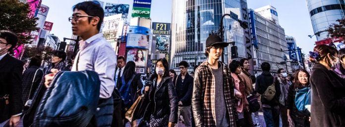 downtown-japan-pedestrains-group-people-walking-urban-street-crossing-road-looking-camera-japanese