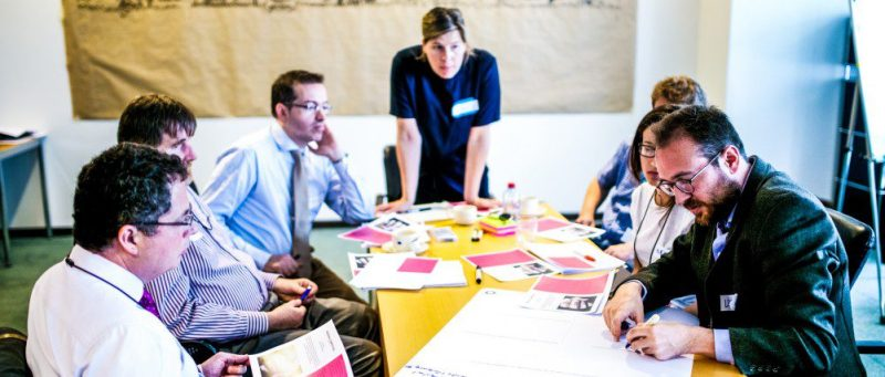 Group Team Working Design Thinking Workshop Business Modelling PLaning Strategy Meeting Teamwork Together Room Table