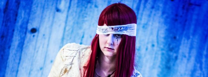 cosplay-woman-girl-blindfolded-medical-nurse-outfit-costume-red-hair-ink-tear-makeup-posing