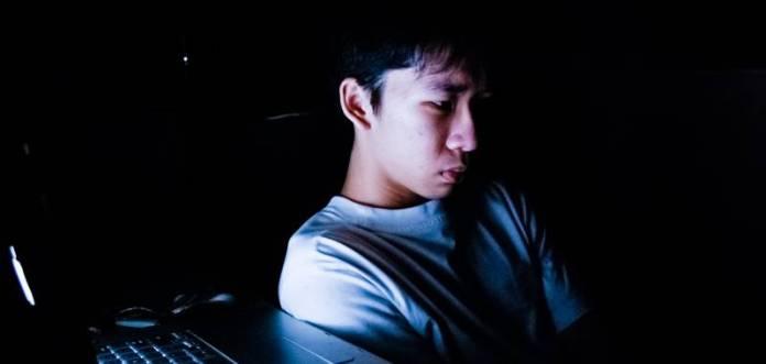 Millennials Social Media Man Guy Boy Sitting In Front Screen Computer Night Dark Cyber Bullying Internet Bad Evil Upset Depressed Sad