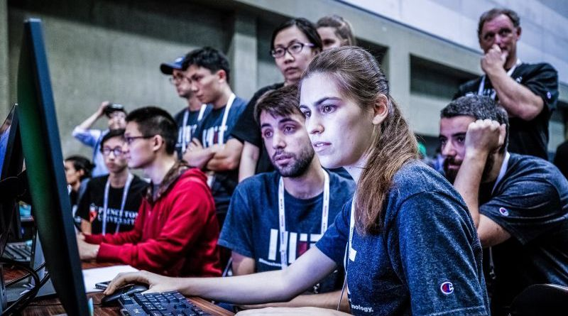 Amazon Smile Charity Donations Program Crowd Sitting Around PC Looking At Screen Working Team