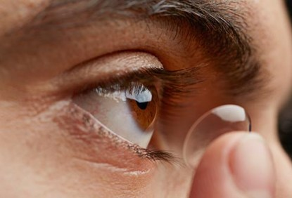 getty_rf_photo_of_man_putting_in_contact_lens