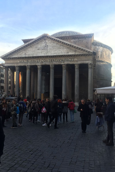 Masses of people crowd around the Pantheon as it stands in all its glory.