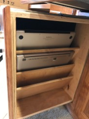 Laptops in pull-out storage