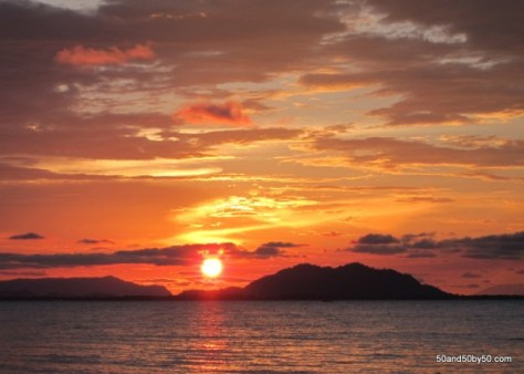 The Borneo sun sets over the Red Sky - gorgeous panoramic vista - Sunset in Bako National Park, Malaysia