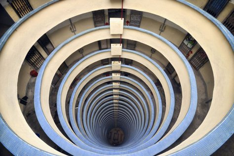 This photo reminds me of the Guggenheim museum in NYC, but it's actually in Hong Kong. The photo is part of the Vertical Horizon photography project, a Hong Kong photography collection featuring Hong Kong architecture